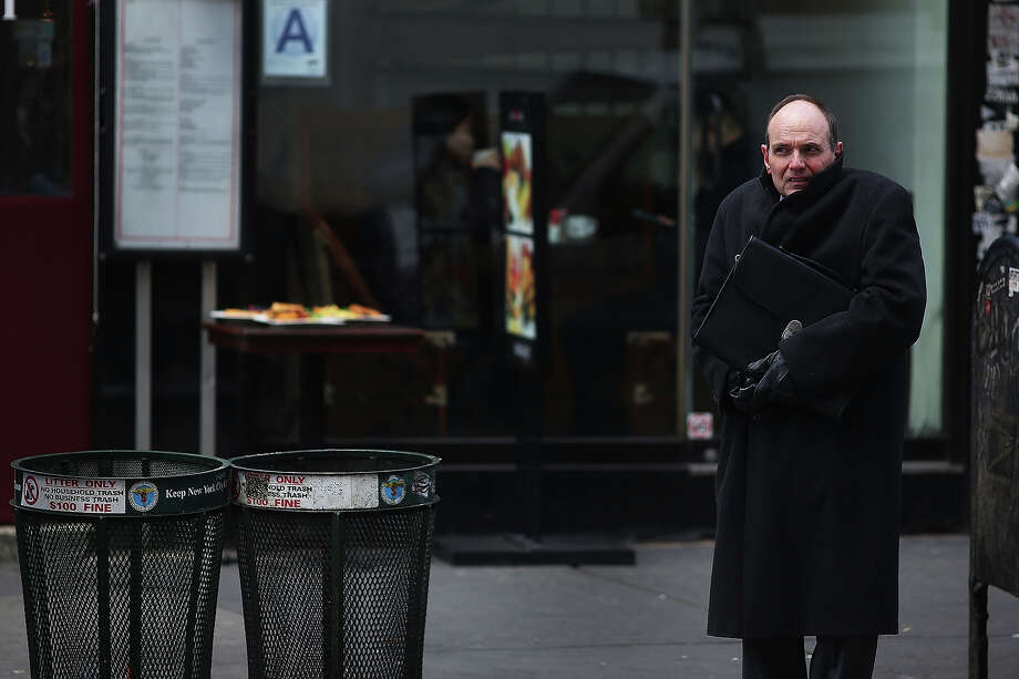 NEW YORK, NY - JANUARY 23: A businessman shivers on a street corner on one of the coldest days of the year on January 23, 2013 in New York City. Much of the Northeast, will be experiencing colder than usual temperatures for the remainder of the week with temperatures in the 20's and a wind chill feeling in the single digits. Photo: Spencer Platt, Getty Images / 2013 Getty Images
