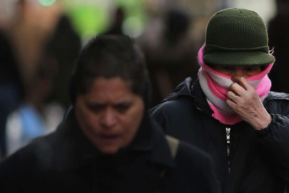 NEW YORK, NY - JANUARY 23: People walk down a street on one of the coldest days of the year on January 23, 2013 in New York City. Much of the Northeast, will be experiencing colder than usual temperatures for the remainder of the week with temperatures in the 20's and a wind chill feeling in the single digits. Photo: Spencer Platt, Getty Images / 2013 Getty Images