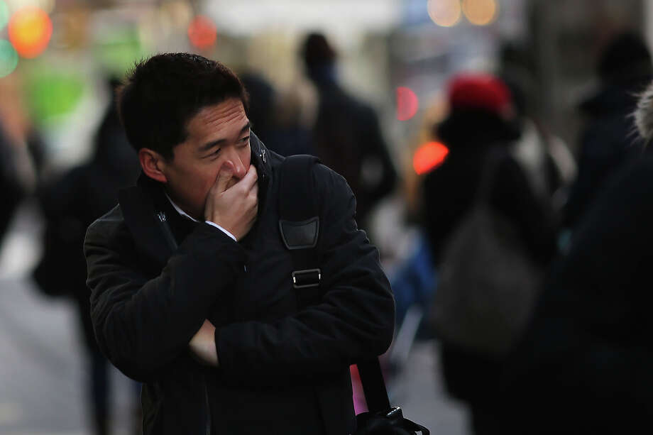 NEW YORK, NY - JANUARY 23: A man tries to keep warm on the street one of the coldest days of the year on January 23, 2013 in New York City. Much of the Northeast, will be experiencing colder than usual temperatures for the remainder of the week with temperatures in the 20's and a wind chill feeling in the single digits. Photo: Spencer Platt, Getty Images / 2013 Getty Images