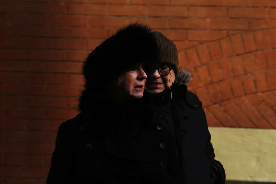 NEW YORK, NY - JANUARY 23: A couple walk down a street on one of the coldest days of the year on Jan