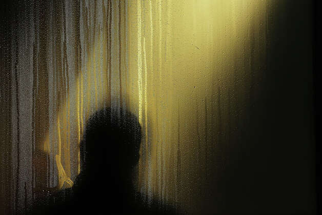 NEW YORK, NY - JANUARY 23: The silhouette of a man is viewed in the steamed window of a Brooklyn coffee shop on one of the coldest days of the year on January 23, 2013 in New York City. Much of the Northeast, will be experiencing colder than usual temperatures for the remainder of the week with temperatures in the 20's and a wind chill feeling in the single digits. Photo: Spencer Platt, Getty Images / 2013 Getty Images
