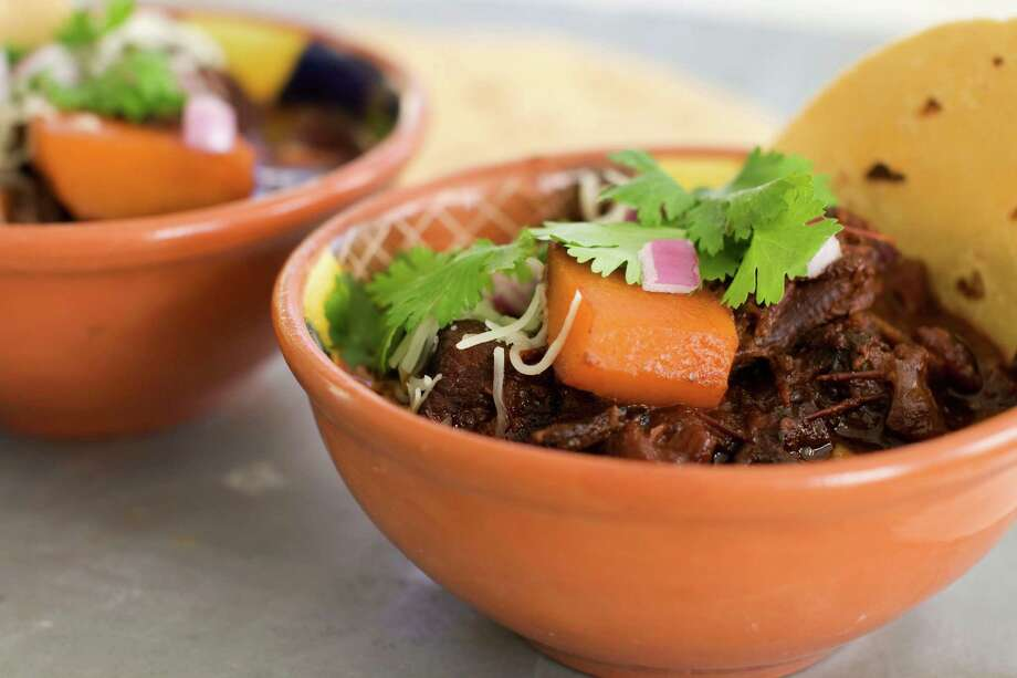 In this image taken on January 7, 2013, Mexican beef brisket and winter squash chili is shown served in bowls in Concord, N.H. (AP Photo/Matthew Mead) Photo: Matthew Mead
