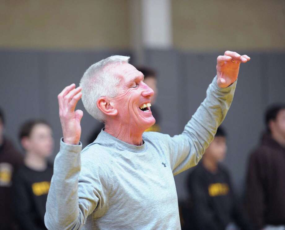 Brunswick wrestling coach Tim Ostyre reacts during a match in the Brunswick Invitational Wrestling Tournament. Photo: Bob Luckey / Greenwich Time
