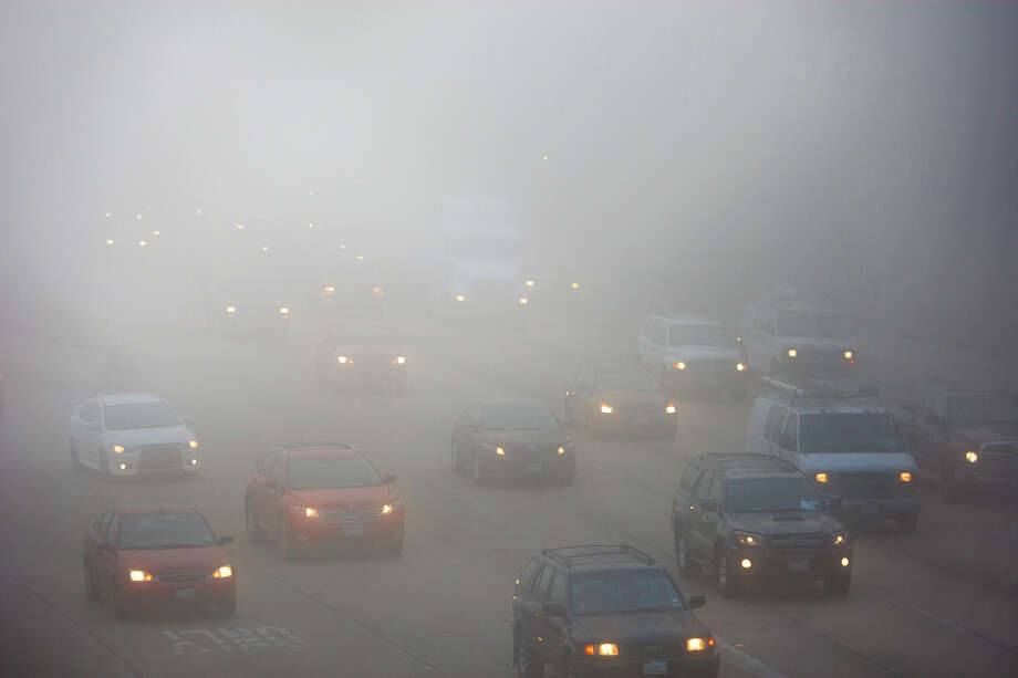 Traffic slows as fog rolls in on I-10 East near Houston Avenue, Wednesday, Jan. 23, 2013, in Houston. 