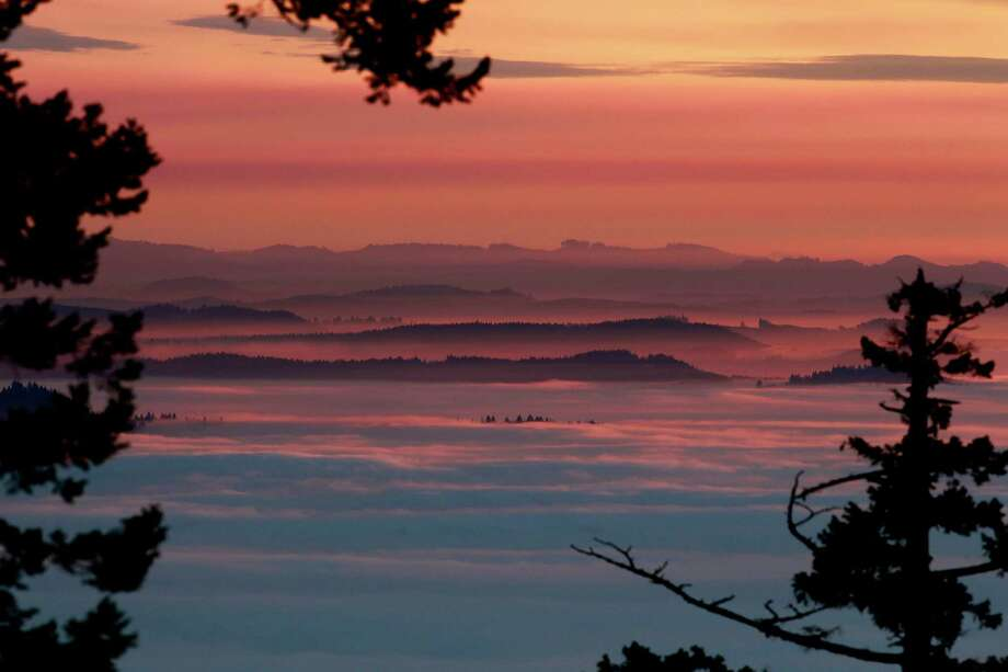 Sunset colors the heavy fog that has been hanging over the Southern Willamette Valley for more than a week near  Eugene, Ore., Tuesday, Jan. 22, 2013. Photo: Kevin Clark, Associated Press / The Register-Guard