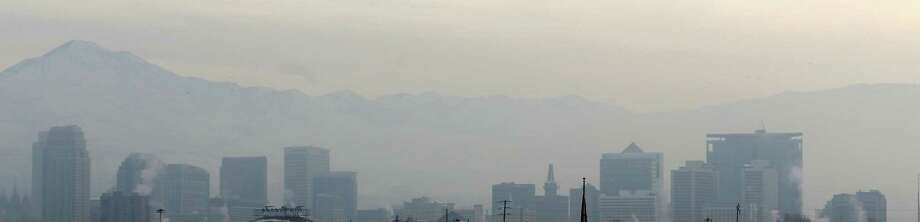 Smog from an inversion hangs over downtown Salt Lake City Wednesday, Jan. 23, 2013 in this panoramic shot. The geography that makes Utah one of the world's most beautiful places also brings the nation's dirtiest air in winter, when an icy fog smothers mountain valleys for days or weeks at a time. Photo: Rick Bowmer, Associated Press / AP