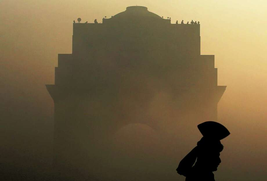 An Indian Army soldier in ceremonial dress stands guard as the India Gate monument is shrouded in heavy fog prior to a dress rehearsal for the annual Republic Day parade in New Delhi, India, Wednesday, Jan. 23, 2013. India celebrates Republic Day annually on Jan. 26. Photo: Kevin Frayer, Associated Press / AP