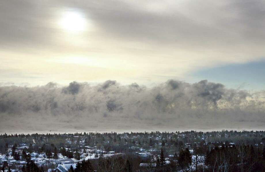 Fog forms over Lake Superior on Monday, Jan. 21, 2013, along the Duluth, Minn. shoreline as the area experiences subzero temperatures. Photo: Bob King, Associated Press / Duluth News Tribune