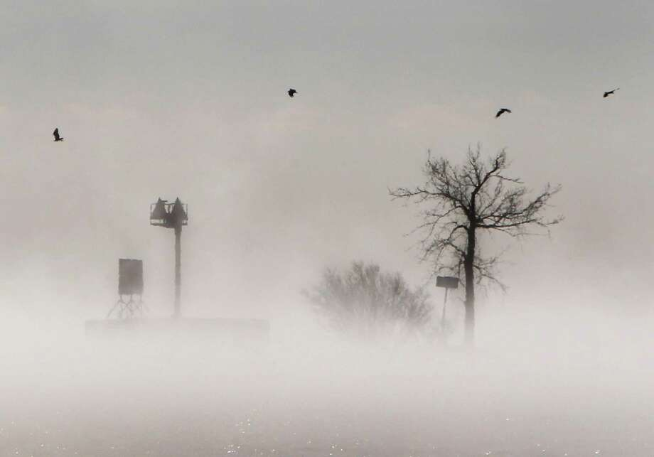 Fog gathers over  Lake Winnebago during a stretch of  bitter cold weather Tuesday Jan. 22, 2013, in Menasha, Wis. Photo: William Glasheen, Associated Press / Wm. Glasheen/The Post-Crescent