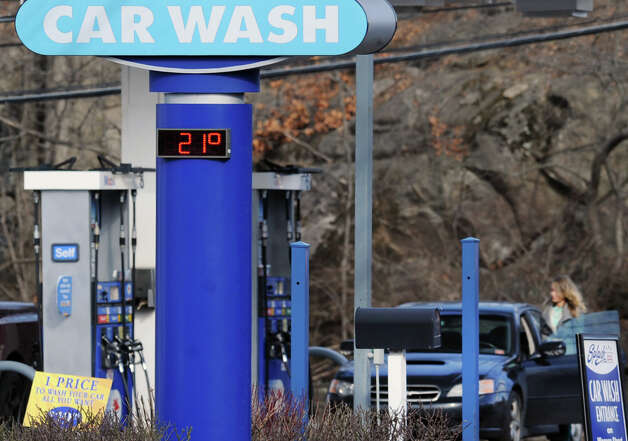 The temperature reads 21 degrees on the sign of the the Splash Car Wash on West Putnam Ave. in Greenwich, Wednesday afternoon, Jan. 23, 2013. The high temperature for the rest of the week is not expected to breach 30 degrees according to the National Weather Service. Photo: Bob Luckey / Greenwich Time