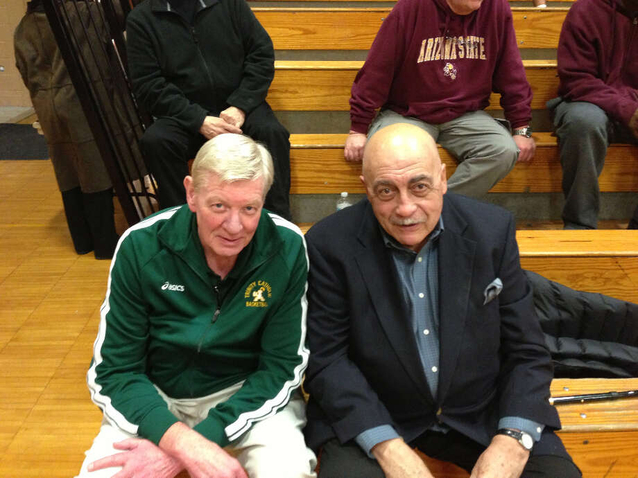 Trinity Catholic coach Mike Walsh (left) and former St. Joseph coach Vito Montelli, close friends, prior to last week's game.