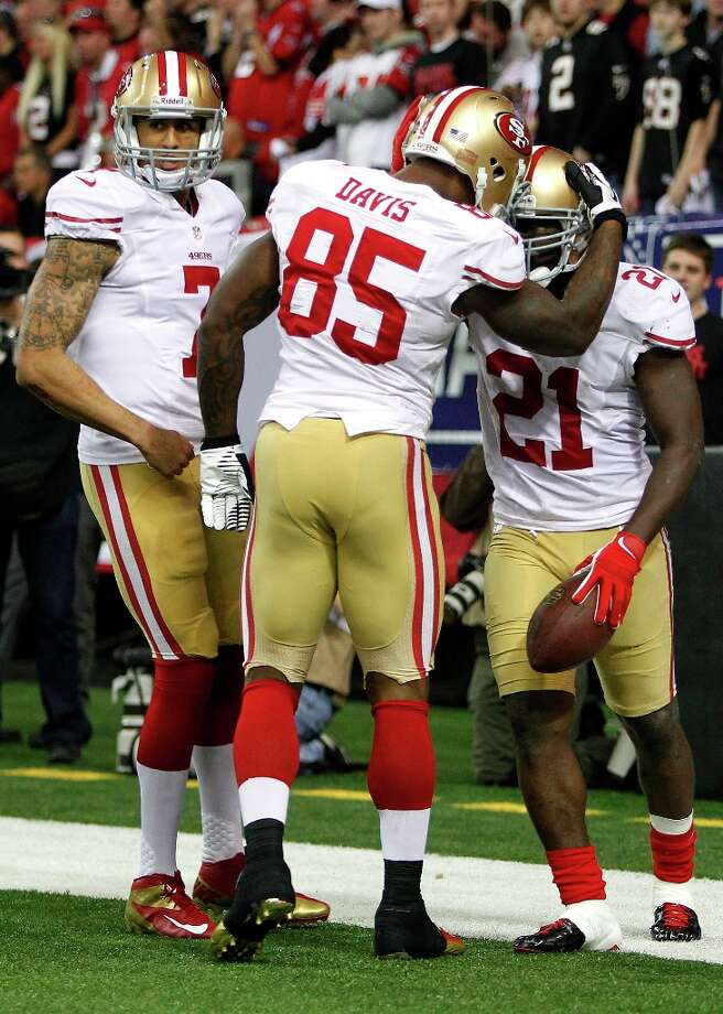 Running back Frank Gore (21)  celebrates with Tight end Vernon Davis (85) and Quarterback Colin Kaepernick (7) after a touchdown during the San Francisco 49ers game against the Atlanta Falcons in the NFC Championship game at the Georgia Dome in Atlanta, GA., on Sunday January 20, 2013. Photo: Michael Macor, The Chronicle / ONLINE_YES