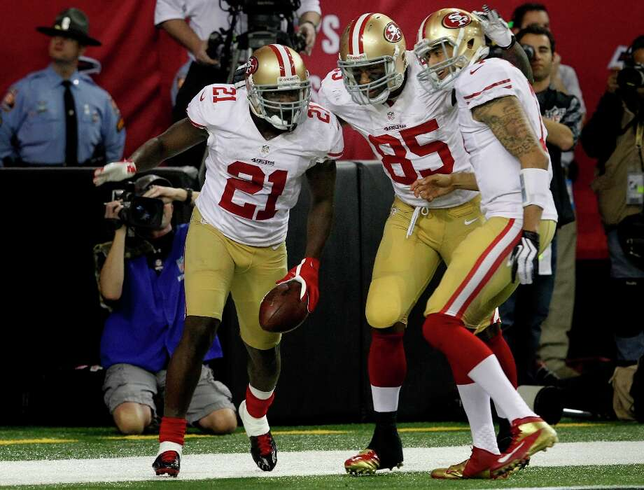 Frank Gore (left), Vernon Davis, and Colin Kaepernick celebrated Gore's game winning touchdown in the fourth quarter. The San Francisco 49ers beat the Atlanta Falcons 28-24 to win the NFC title and advance to the Super Bowl Sunday January 20, 2013. Photo: Brant Ward, The Chronicle / ONLINE_YES