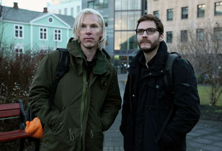 In this undated photo released Wednesday Jan.23, 2013, by DreamWorks Studios,  Benedict Cumberbatch as Julian Assange (left) with Daniel Bruhl as Daniel Domscheit-Berg are seen during the filming of  the WikiLeaks drama, The Fifth Estate, by the film company, in Reykjavik, Iceland.  The film traces the  early days of WikiLeaks, culminating in the release of a series of controversial and history changing information leaks,  and is due out in the USA in November.(AP Photo/ Frank Connor / DreamWorks Studios) Photo: Frank Connor/DreamWorks Studios