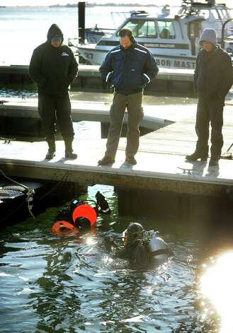 The Bridgeport Police Dive Team conducts underwater search exercises from the Water Street Dock on Bridgeport Harbor on Wednesday, January, 23, 2013. The water was about 40 degrees, warm compared to the air temperatures which hovered in the single digits. Photo: Brian A. Pounds