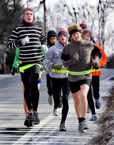 The Danbury High School boys track team braved Wednesday's frigid weather for an early afternoon run on Clapboard Ridge Road in Danbury, January 23, 2013. Photo: Carol Kaliff / The News-Times