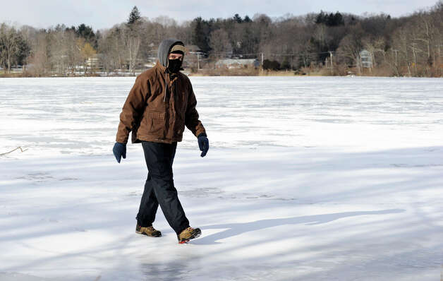 Ben Marino, 21, of New Fairfield, walks on a frozen Ball Pond in New Fairfield, Wednesday, January 23, 2013. Photo: Carol Kaliff / The News-Times