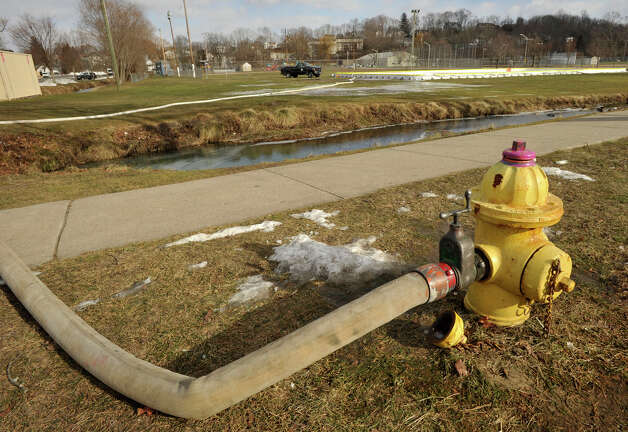Water flows from a fire hydrant into the outdoor ice rink at Rogers Park in Danbury on Wednesday, Jan. 23, 2013. Photo: Jason Rearick / The News-Times