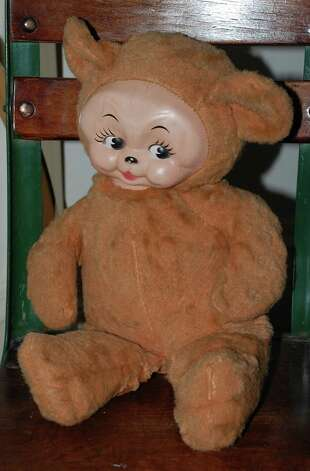 Given the popularity of the Kewpie doll in the early 1900s, toy manufacturers began putting Kewpie faces on bears as well, such as this one in the new Westport Historical Society exhibit. Photo: Jarret Liotta / Westport News contributed