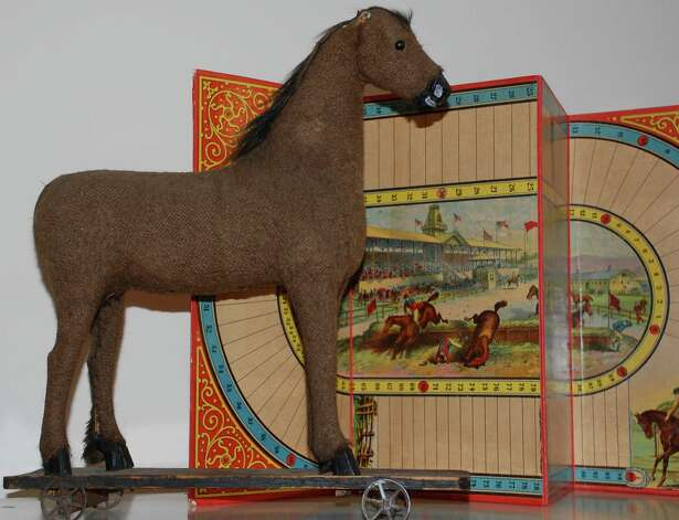 "This antique horse toy was added to the ""Treasures Revealed!"" exhibit by Elizabeth DeVoll, the Westport Historical Society's education director, because, ""I just thought it was cool."" Photo: Jarret Liotta / Westport News contributed"