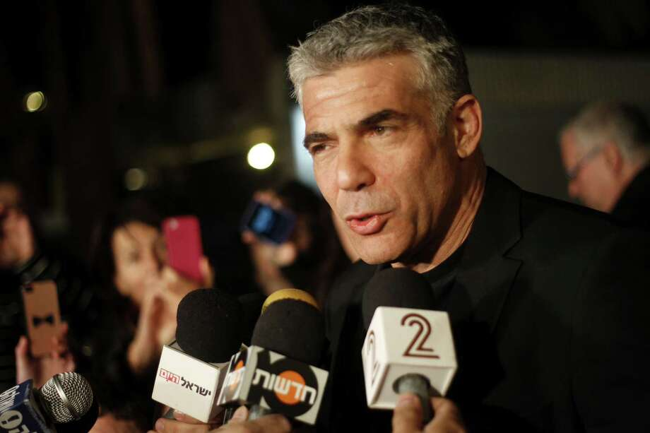 Yair Lapid, leader of Yesh Atid party gives a statement outside his home in Tel Aviv, on Wednesday. Yesh Atid turned election forecasts on their heads and dealt Israeli Prime Minster Benjamin Netanyahu a sharp blow. Photo: Ariel Schalit, STF / AP