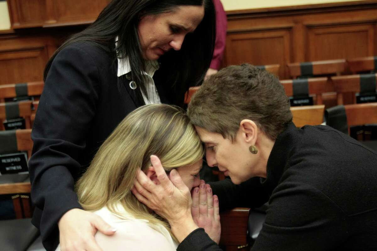 The woman in background comforting Sgt. Norris is Colleen Bushnell, USAF staff sgt, retired. She was abused at Lackland, according to her. Technical Sergeant Jennifer Norris, USAF, (ret) is comforted by Nancy J. Parrish, President of Protect Our Defenders, after she testified at a review of sexual misconduct by basic training instructors at Lackland Air Force Base by House Armed Services Committee, 2118 Rayburn Building. Parrish helped Norris prepare for the testimony.(Photo by Susan Biddle)