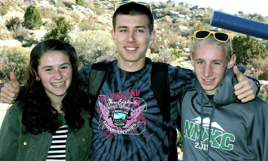 Emily Day, Ryan Clarke, center, and John Hansell of New Milford High School pose for a keepsake photo during their December, 2012 stay in New Mexico for the national Junior Olympics cross country competition.  Courtesy of Audrey Day Photo: Norm Cummings