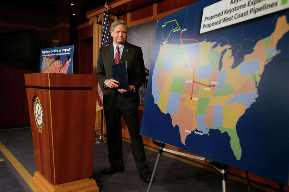 Sen. John Hoeven, R-N.D,  walks toward a illustration of the Keystone Pipeline and proposed expansions, after a news conference on Capitol Hill in Washington, Wednesday, Jan. 23, 2013. A key approval of a revised route for the Keystone XL oil pipeline from Canada to the U.S. Gulf Coast puts the long-delayed project back in the hands of the U.S. government.  (AP Photo/Jacquelyn Martin) Photo: Jacquelyn Martin, Associated Press / AP