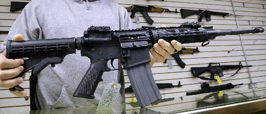 This photo shows a AR-15 rifle. (AP Photo/Seth Perlman)