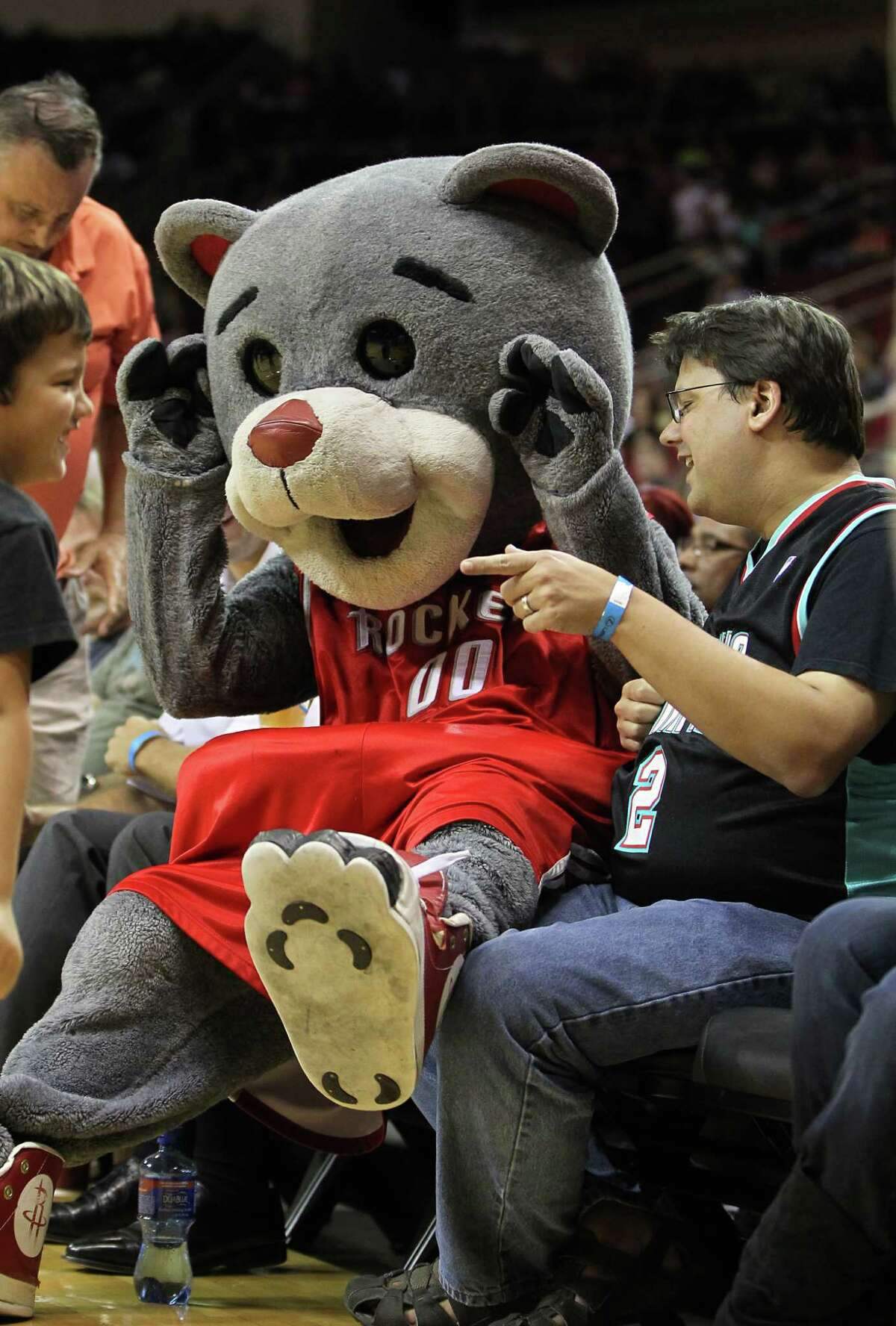 Clutch the Bear jokes around with fans at a Rockets game.
