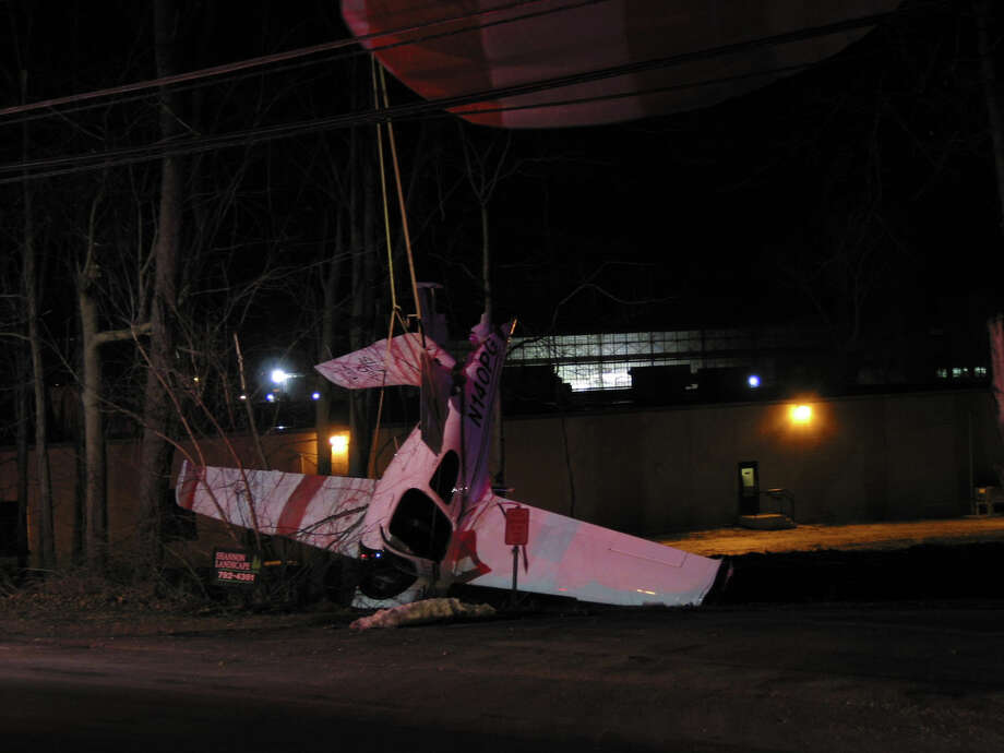 A small plane crashed near South Street in Danbury on Tuesday, Jan. 22, 2013, after deploying a parachute to break its fall. Photo: Contributed Photo/Rob Fish