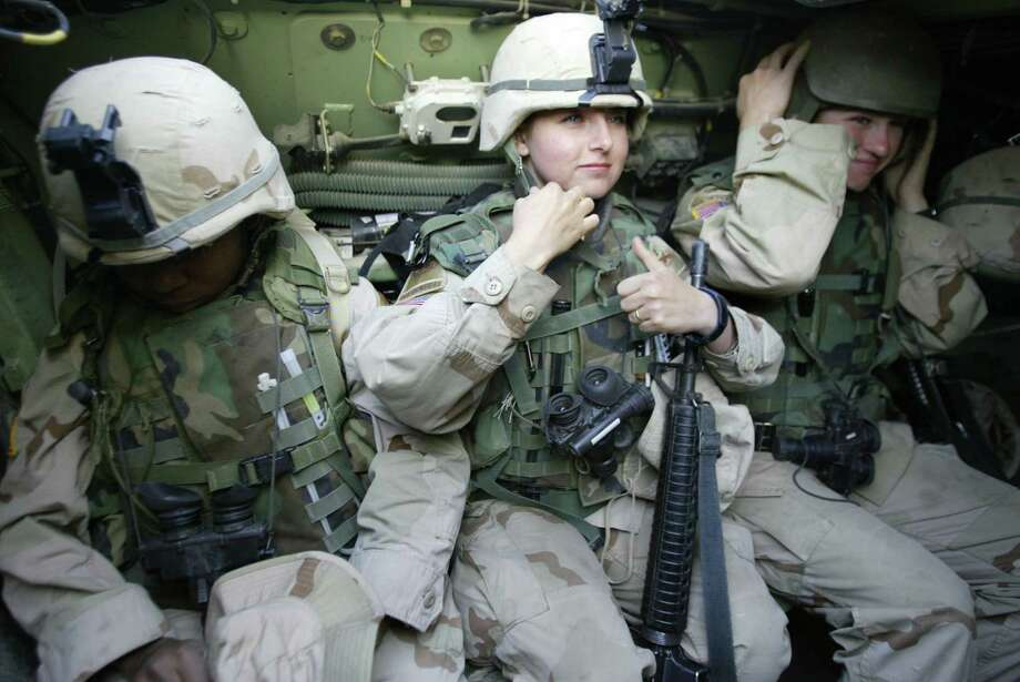 This 2004 photo shows female soldiers from the U.S. 1st Cavalry on patrol in Baghdad. Since 1994, women could not serve with smaller ground combat units. Photo: KARIM SAHIB, Staff / AFP ImageForum
