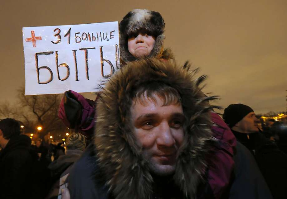 "A protester holds a sign reading ""Let hospital No. 31 be"" at a demonstration in St. Petersburg, Russia. Photo: Dmitry Lovetsky, Associated Press"