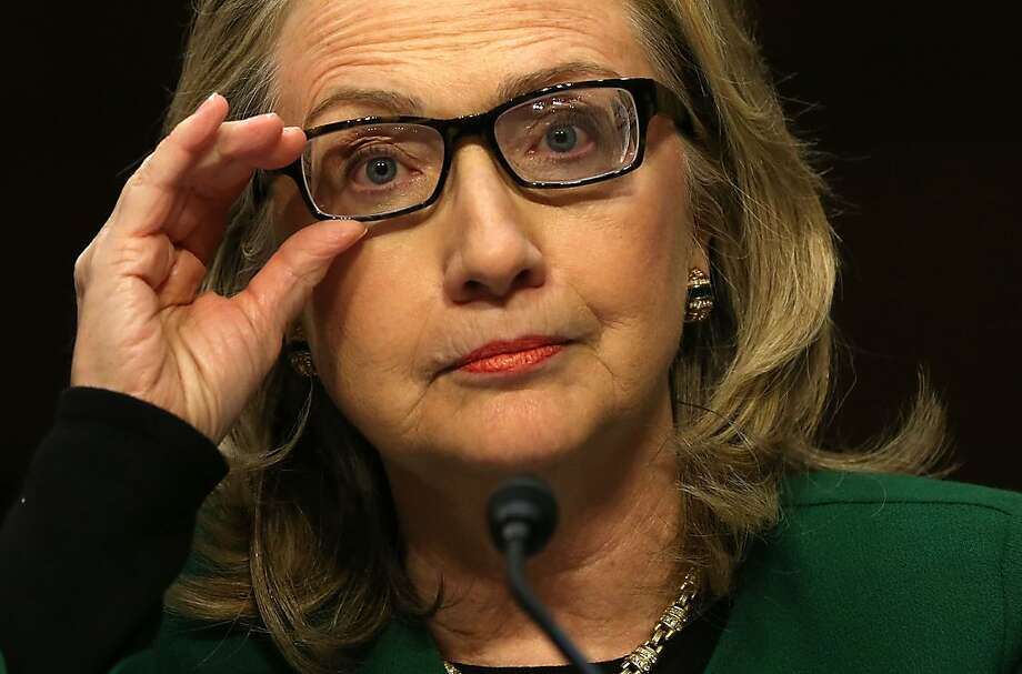 Secretary of State Hillary Rodham Clinton defends the response to the deadly attack on the Benghazi mission and State Department efforts to increase security during in testimony before the Senate Foreign Relations Committee. Photo: Alex Wong, Getty Images