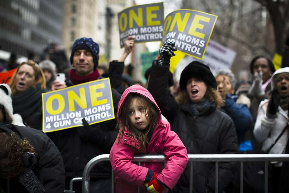 Emma Clyman, 5, of Manhattan, stands on a police barricade outside city hall park during the One Million Moms for Gun Control Rally, Jan. 21, 2012, in New York. Demonstrators called for new gun control legislation, demanding a ban on assault weapons and stricter regulations on gun purchases. (AP Photo/John Minchillo) Photo: John Minchillo, Associated Press
