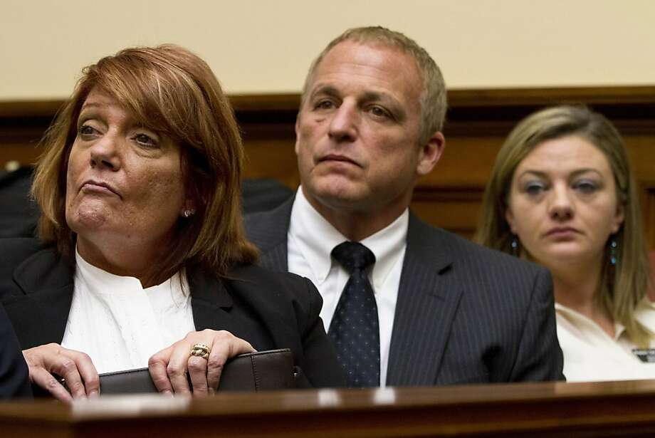 Air Force Chief Master Sgt. (Ret.) Cindy McNally, left, waits to testify before a House Armed Services Committee hearing on sexual misconduct by basic training instructors at Lackland Air Force Base, with her husband, center, and fellow Protect Our Defenders witness Air Force Technical Sgt. (Ret.) Jennifer Norris, on Capitol Hill in Washington on Wednesday, Jan. 23, 2013. (AP Photo/Jacquelyn Martin) Photo: Jacquelyn Martin, Associated Press