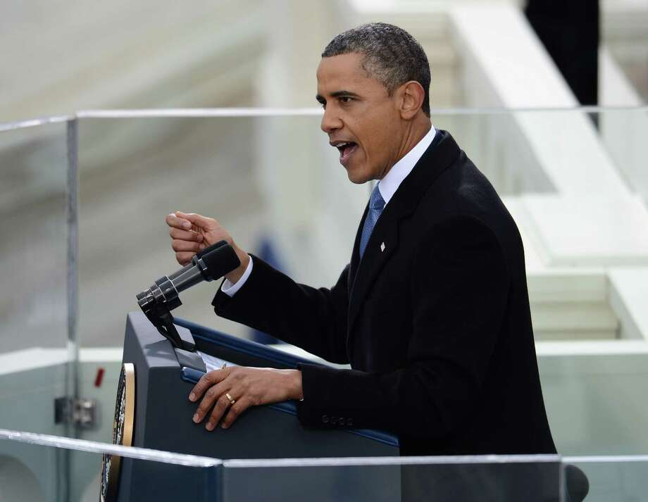 President Barack Obama gives his inauguration speech at the Capitol on Monday in Washington, D.C. Photo: EMMANUEL DUNAND, Staff / EMMANUEL DUNAND