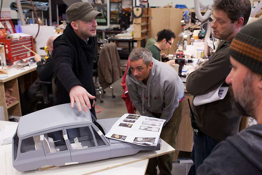 """ParaNorman"" co-director Chris Butler (left) discusses a car model. Photo: Focus Features"