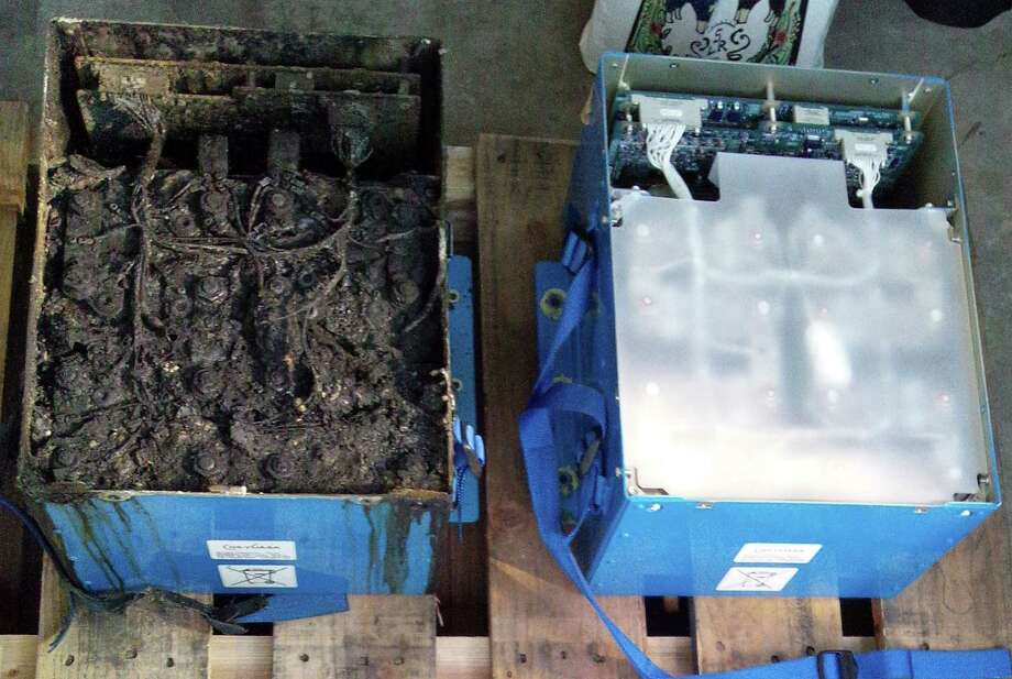 This Japanese government photo shows the burned lithium-ion battery, left, and an undamaged backup battery on an All Nippon Airways Boeing 787 that was forced to make an emergency landing Jan. 16 in Japan. Photo: HOEP / Japan Transport Safety Board