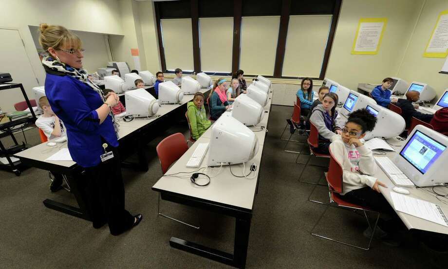 Library Media Specialist  Jamie Holmes  speaks with her students on the subject of Digital Citizenship Jan. 23, 2013 at School 18 in Troy, N.Y.    (Skip Dickstein/Times Union) Photo: SKIP DICKSTEIN / 00020781A