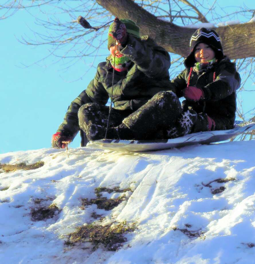 It was a nice bright and sunny day in Albany's Washington Park when these two sledders hit the hill and had a ball. They had capsized twice ? but it did not cool their enthusiasm a bit. (Willard Bridgham)