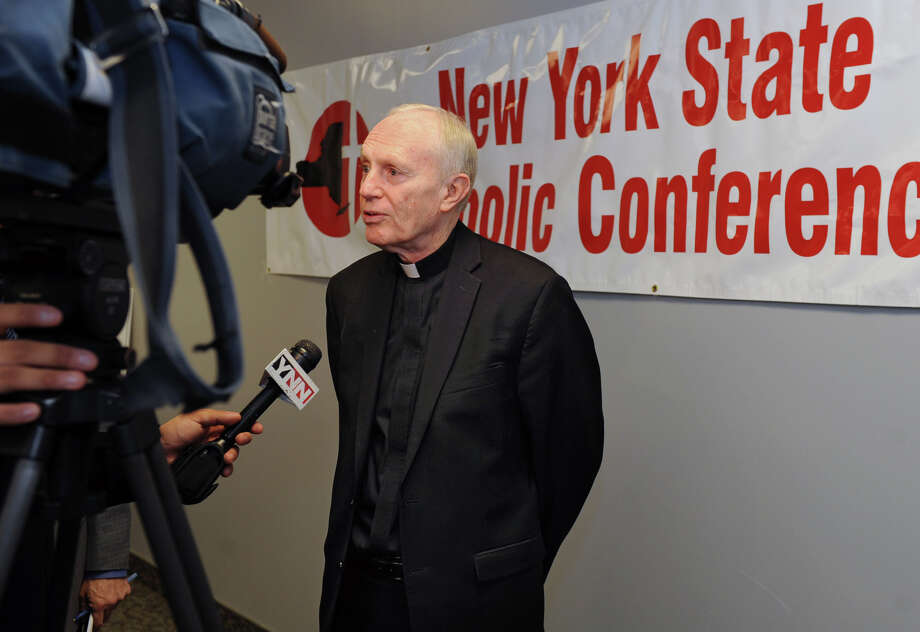 Bishop Howard Hubbard of Albany, representing five upstate dioceses, talks to the press after a check was presented during a press conference announcing a donation of $1,364,822 from Catholic Charities in relief funds for downstate victims of Superstorm Sandy at Catholic Charities of the Dioces on Wednesday Jan. 23, 2013 in Albany, N.Y. (Lori Van Buren / Times Union) Photo: Lori Van Buren