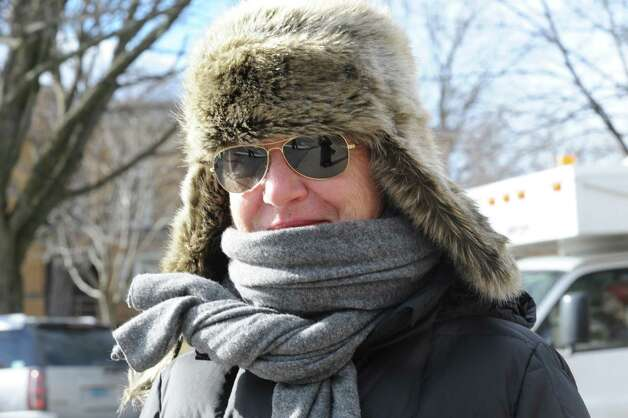 Mireille Lemarchand, of Greenwich, walks on Greenwich Avenue, keeping warm in Greenwich, Conn., Wedesday, Jan. 23, 2013.   Greenwich weather is cold, temperature of 18 F, with mostly cloud with chance of snow. Photo: Helen Neafsey / Greenwich Time