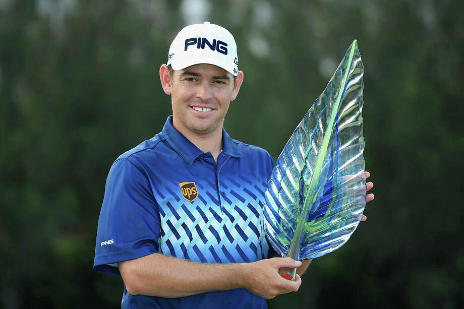DURBAN, SOUTH AFRICA - JANUARY 13:  Louis Oosthuizen of South Africa poses with the trophy after securing victory during the final round of the Volvo Champions at Durban Country Club on January 13, 2013 in Durban, South Africa.  (Photo by Richard Heathcote/Getty Images) Photo: Richard Heathcote, Staff / 2013 Getty Images