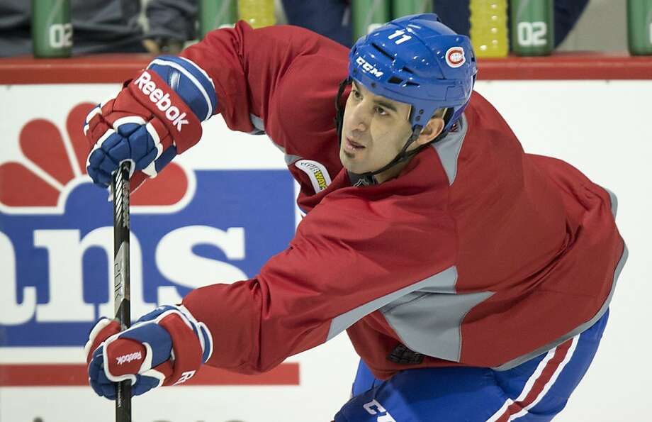Scott Gomez signed a seven-year deal with the Rangers in 2007. Photo: Paul Chiasson, Associated Press