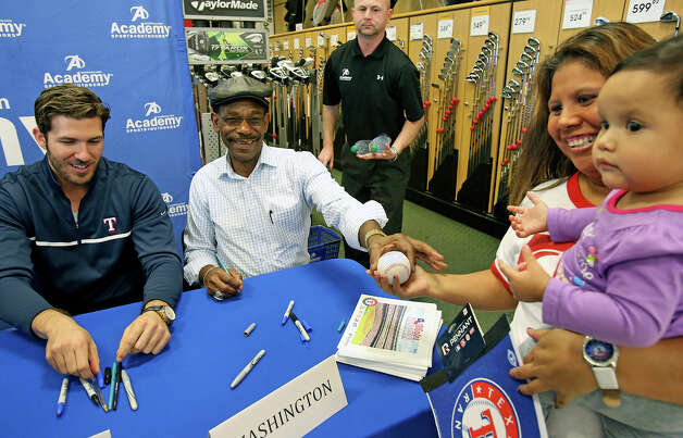 Seven month old Adyson Stiftinger loses interest while her mom, Morgan Stiftinger talks with Texas Ranger baseball players as they sign autographs at the Academy Sports and Outdoors store at 1604 and NW MIlitary on January 23, 2013. Photo: Tom Reel, San Antonio Express-News / ©2012 San Antono Express-News