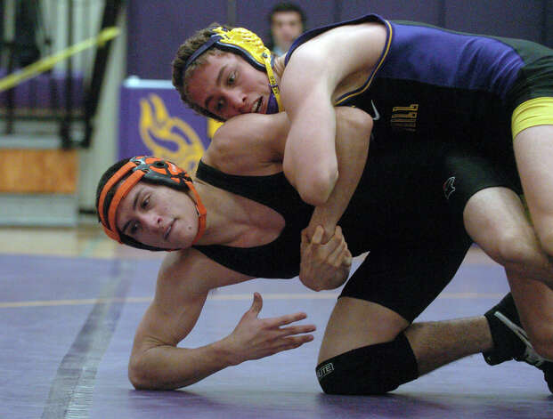 Westhill's Chris Mazur, right, and Stamford's Christian Llanos wrestle in the 138 pound weight class as Westhill hosts Stamford High School in a wrestling match in Stamford, Conn., Jan. 23, 2013. Photo: Keelin Daly / Stamford Advocate Riverbend Stamford, CT