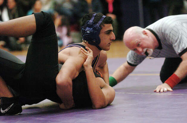 Westhill's Monir Koummal pins Stamford's Brandon Yoc in the 172 pound weight class as Westhill hosts Stamford High School in a wrestling match in Stamford, Conn., Jan. 23, 2013. Photo: Keelin Daly / Stamford Advocate Riverbend Stamford, CT