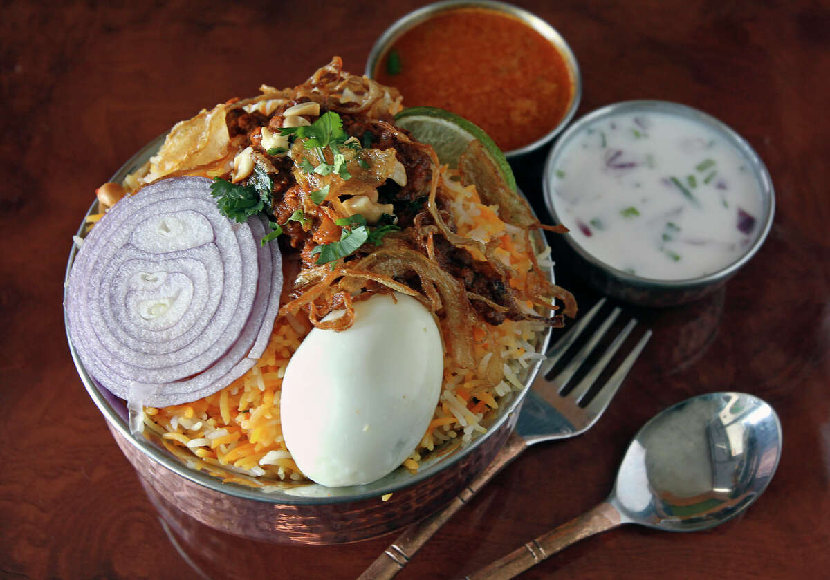 Kheema Biryani is a stew served atop fragrant basmati rice with a pair of sauces.
