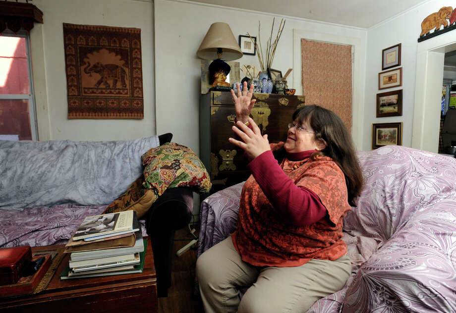 Sheila Maher, 51, talks about the shape her roof was in before Mark Edwards replaced it for her. Photo taken in the living room of her Newtown home, Tuesday, January 22, 2013. Photo: Carol Kaliff / The News-Times